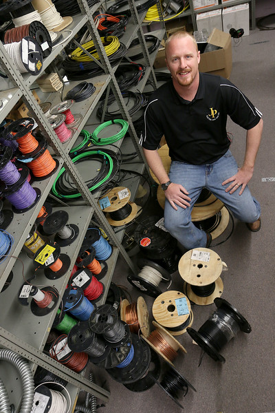 Montachusett Regional Vocational Technical School 2002 graduate Josh Page and owner of J.P. Electric and Son Inc., in Fitchburg. SENTINEL & ENTERPRISE/JOHN LOVE