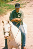 "Bob was a neighbor of my aunts when they lived outside Eureka, Missouri and a consummate horseman as you can see. He would have been a cowboy, but there wasn't much to that as a career anymore. Weekdays, he drove to Indianapolis and picked up a tractor-trailer rig, drove a load to California and back, then drove to Eureka an hour west of St Louis. Some weekends, he would then drive to Oklahoma to punch cows with some friends who stayed with the life.<br /> <br /> A lot of people have recorded it, but my favorite version of ""Night Rider's Lament which always reminds me of him is Nanci Griffith's (a duet with Don Edwards) that you can hear here:  <a href=""http://www.youtube.com/watch?v=tADS_eWkG3A"">http://www.youtube.com/watch?v=tADS_eWkG3A</a><br /> <br /> His wife Joanie was a champion barrel racer who worked a cattle auction during the week. One weekend he returned home to hear something snuffling in the downstairs closet. Someone had brought an achondroplastic dwarf bull to the auction instead of euthanizing it on the ranch as is normal at the birth of what cattlemen call a ""Snorter Dwarf."" (Skull deformation make the animal breathe stertorously.) Joanie could not stand to let it be killed. So she named it Butch and raised it in the house until it got too big and then turned it out in an orchard pasture.<br /> <br /> The reason most cattle are easy to move around is that they mostly have only encountered humans as towering figures on horseback. Butch did not see things that way and weighed well over 1000 pounds.<br /> <br /> One night we heard screaming in the orchard pasture, probably a bobcat in retrospect, but they have a godawful scream so I went down from my aunts' place and he came up from theirs. Whatever it was, was gone, but it had angried up Butch's blood some and he treed us. I heard a lot of cowboy stories up in that tree 'til the sun came up and Butch lost interest."