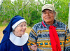 The gentleman is Bobby C Billie, council member of the Original Miccosukee Semanolee Nation Aboriginal Peoples. The woman on his left is Marion Nicolay, an historic re-enactor who was appearing as Deaconess Harriet Bedell a missionary/nurse who came to the Everglades in 1933 at the age of 57. She died in 1969 at the age of 94. Ms Nikolay was so effective in her appearance and character that Mr Billie who had met her in his younger life was initially somewhat confused to meet her once again since she would now be 137 years old.<br /> <br /> For more, see Other>Big Cypress Swamp Heritage Festival