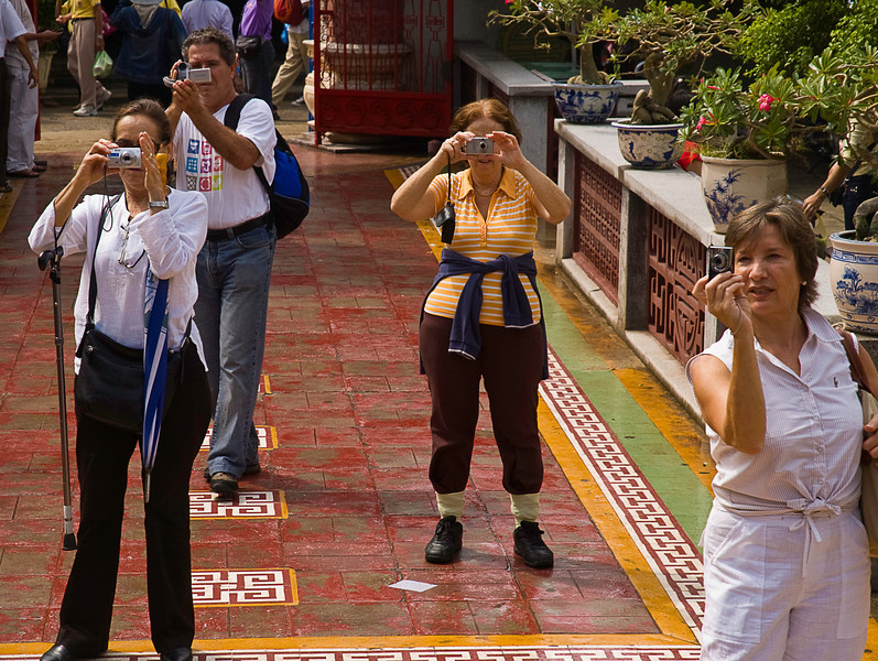 For sure I'm in the picture taken by the lady with her pants cuffs tucked into her socks, don't know about the others; exterior, Chinese Buddhist Temple, Hoi An, Vietnam (q.v)