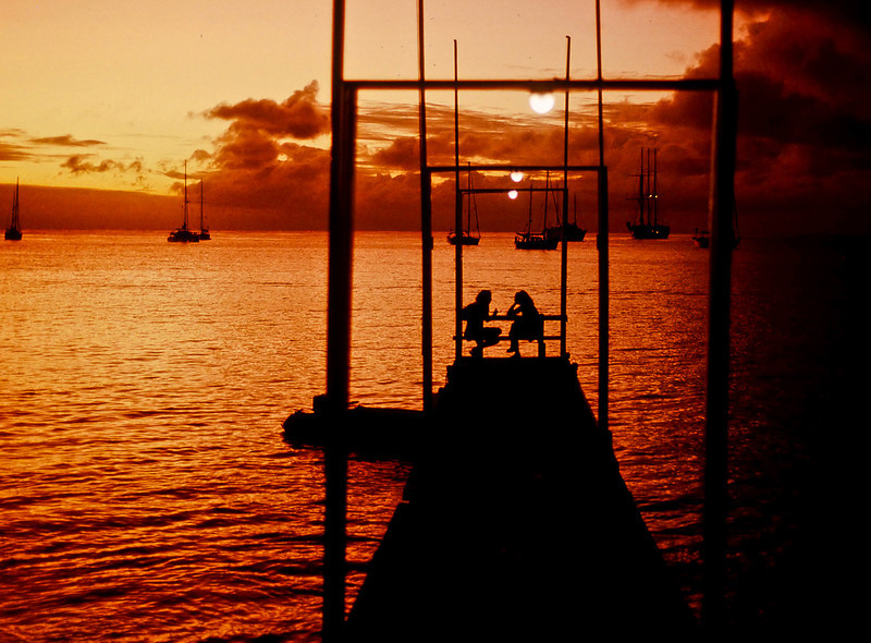 Sundown conversation on a dock in Admiralty Bay, Bequia; February, 1994 (q.v.>Travel>Caribbean Islands>Bequia)