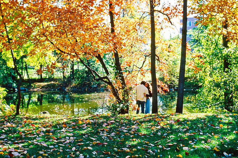 The Grand River runs through the middle of Michigan State University campus and is a magnetic spot for lovers like these two seen here on October 20, 1973 just as Richard Nixon was ordering Attorney General Elliot Richardson to dismiss Watergate Special Prosecutor Archibald Cox.  Richardson resigned; His Deputy AG William Ruckelshaus likewise refused to dismiss Cox, and resigned. This left Solicitor General Robert Bork as the highest-ranking member of the Justice Department; Bork dismissed Cox.<br /> <br /> But that has nothing to do with young love in the fall, but everything to do with why I remember the date of this trip back to MSU with Gayle on which I surprised us both by proposing we get married.