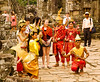 Dancers, guide and tourists at Angkor Thom, Angkor complex, Cambodia