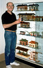 Robert Sponsel prepares a display of his antique toy depots.