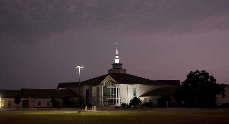 Manchaca Baptist Church at dusk as a storm rolls in.