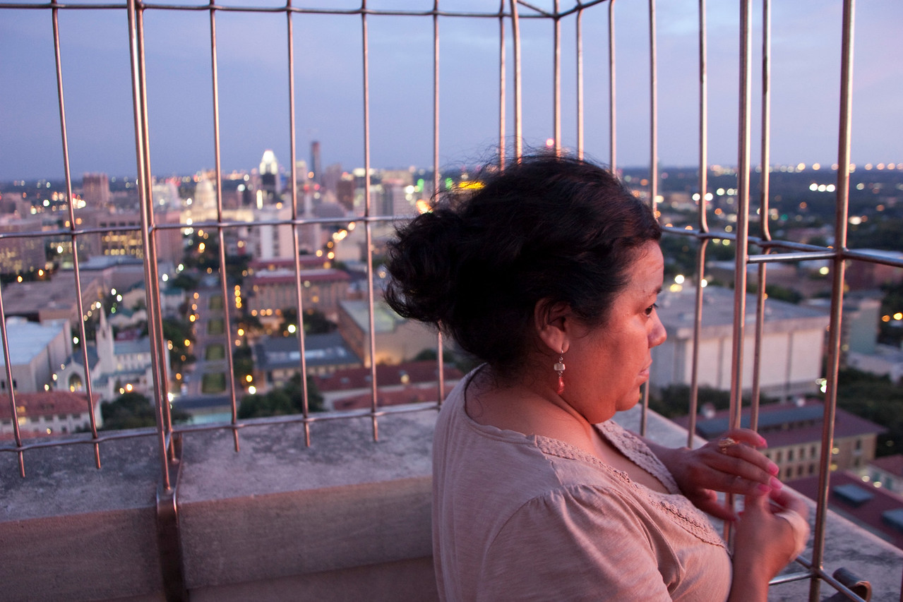 Connie watching the sun set from the observation deck of the UT Clock Tower.