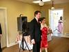 Groomsman Ryan Harris escorts Bridesmaid Andrea Neal
