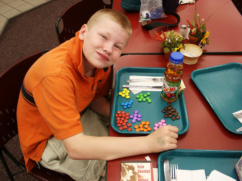 Jacob sorting smarties in the Head Smashed In cafeteria.