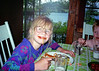 My daughter enjoying spaghetti at her great aunt's cottage.