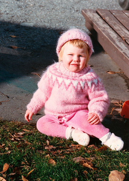Helen in her pink outfit in our Glenburnie backyard. She's around two making this  1988.