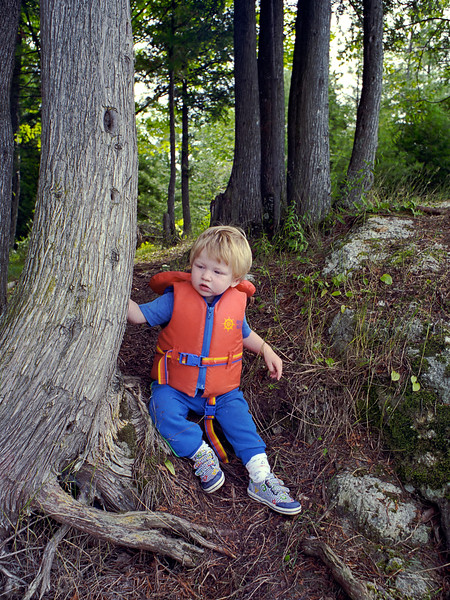 Jacob in a life jacket at the cottage.