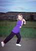 My daughter caught in flash near twilight in the Drumheller valley. This was our dinosaur camp trip.