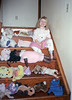 My daughter showing off her doll collection.