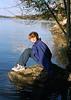 Helen sitting on Mermaid Rock at Dog Lake.