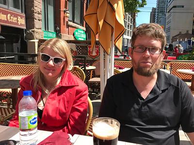 Helen and Tim enjoying curbside beverages.