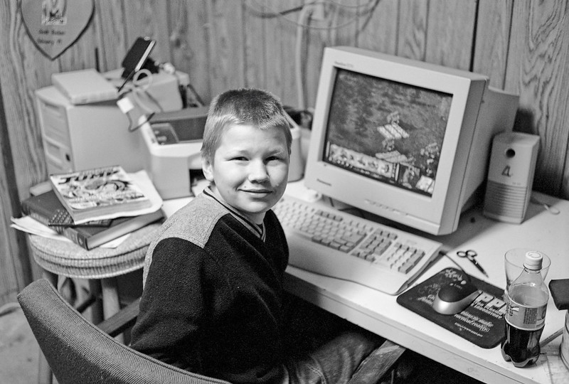 Jacob in the Sunnyside house basement computer room.
