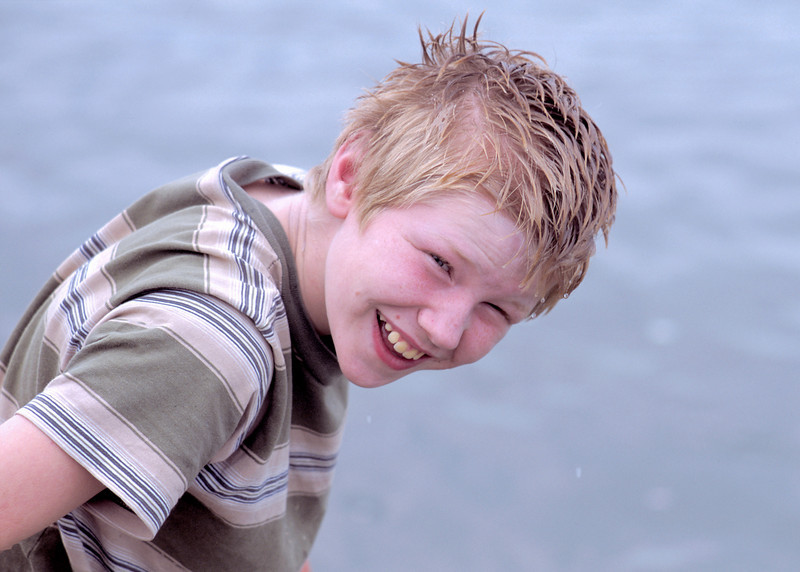 Jacob washing face in Yukon river. August 2002.