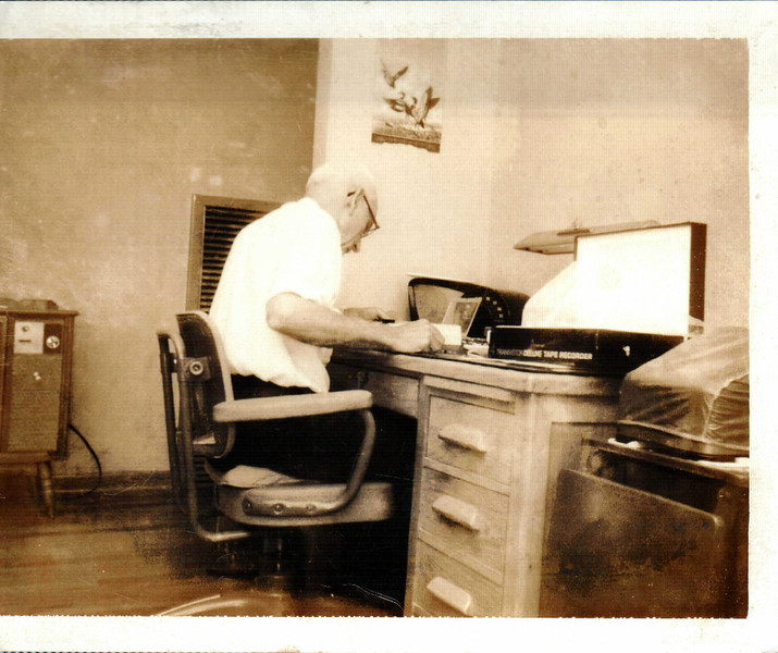 My Maternal Grandfather, O.T. Myers balancing a clients books.