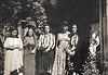 Mahin in center standing beside Mali's paternal grandmother in the poka dot dress and neighbors.