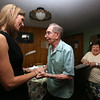 WWII veteran Henry Naruszewicz, 103, of Lowell, meets with US Rep. Lori Trahan at his home. Lori Trahan thanks Naruszewicz after visit, as his daughter Dorothy Flanagan of Lowell looks on. (SUN/Julia Malakie)