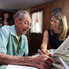 WWII veteran Henry Naruszewicz, 103, of Lowell, meets with US Rep. Lori Trahan at his home. (SUN/Julia Malakie)