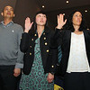 Swearing in at the naturalization ceremony at Fitchburg State University on Thusday is from left. Chuttharat Kem from Cambodia living in Lowell, Man ki Hui living in Westboro and from Hong Kong and Daniela Munafo from Argentina now living in South Hampton. SENTINEL & ENTERPRISE/JOHN LOVE