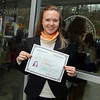 Elena Sulimenko, 30 from Russsia now living in Reading MA. shows off her certificate that states she is now a United States citizen at the naturalization ceremony held at Fitchburg State University on Thursday afternoon. SENTINEL & ENTERPRISE/JOHN LOVE