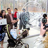 Sherey Boulis from Egypt holds her certificate showing she is a new United States citizen as her picture is taken with her family at the naturalization ceremony held at Fitchburg State University on Thursday. With her is her husband Basem Boulis, son Daniel, 2, and David, 3 weeks old. SENTINEL & ENTERPRISE/JOHN LOVE