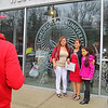 Kevin Rosa takes a picture of his Grandmother Gloria Moreno, center from El Salvador now living in Florence MA. with Gilma Rosa and Giselle Rosa, 9, at the naturalization ceremony held at Fitchburg State University on Thursday afternoon. SENTINEL & ENTERPRISE/JOHN LOVE