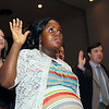Eunice Garrett from Liberia who now lives in Worcester swears in as a new citizen at the naturalization ceremony held at Fitchburg State University on Thursday afternoon. SENTINEL & ENTERPRISE/JOHN LOVE
