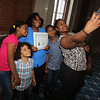 Newly sworn in U.S. citizens and friends and family leave Lowell Memorial Auditorium after naturalization ceremony. Flor Cedano, right, takes a photo of her mother Altagracia Amezquita with Flor's children Kiana Tineo, 11, Jayden Bueno, 20, and Rayniel Gomez, 4, after Amezquita became a citizen. All live in Salem, MA. Cedano and her mother are originally from Dominican Republic.(SUN/Julia Malakie)
