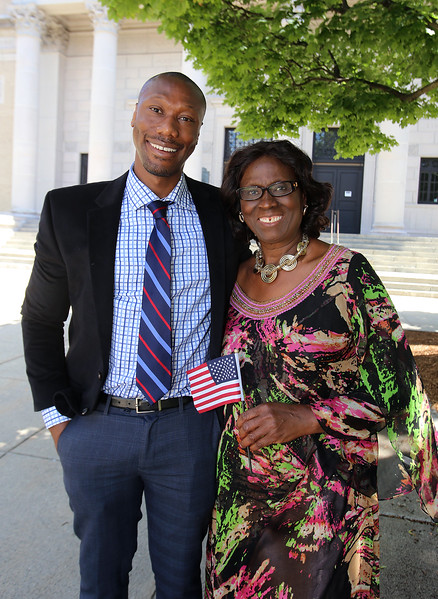 Newly sworn in U.S. citizen, left, with his mother, outside Lowell Memorial Auditorium after naturalization ceremony. (SUN/Julia Malakie)