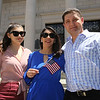 Newly sworn in U.S. citizens and friends and family leave Lowell Memorial Auditorium after naturalization ceremony. Jucelia Szytko of Watertown, center, is new citizen. (SUN/Julia Malakie)