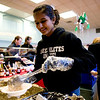 Volunteer Maithreyi Gopalakrishnan, of Superior, dishes out oatmeal during the annual Oatmeal Festival at Pioneer Elementary school in Lafayette, Saturday, Jan. 9, 2009. <br /> KASIA BROUSSALIAN