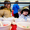 Aveena Shah (right), 5, and her sister Ayesha, 10, both of Erie, look through the choices of toppings during the annual Oatmeal Festival at Pioneer Elementary school in Lafayette, Saturday, Jan. 9, 2009. <br /> KASIA BROUSSALIAN