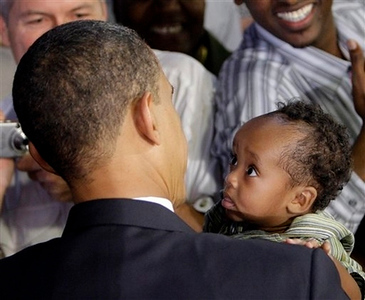 Democratic presidential candidate Sen. Barack Obama D-Ill., holds Eli Werness, 9-months, from Raleigh, as he shakes hands after his speech about the economy, Monday, June 9, 2008, at the North Carolina State Fairgrounds in Raleigh, N.C. (AP Photo/Alex Brandon)