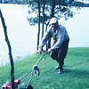 bert, mowing the lawn at Robert's Lodge on Lobstick Bay, Canada