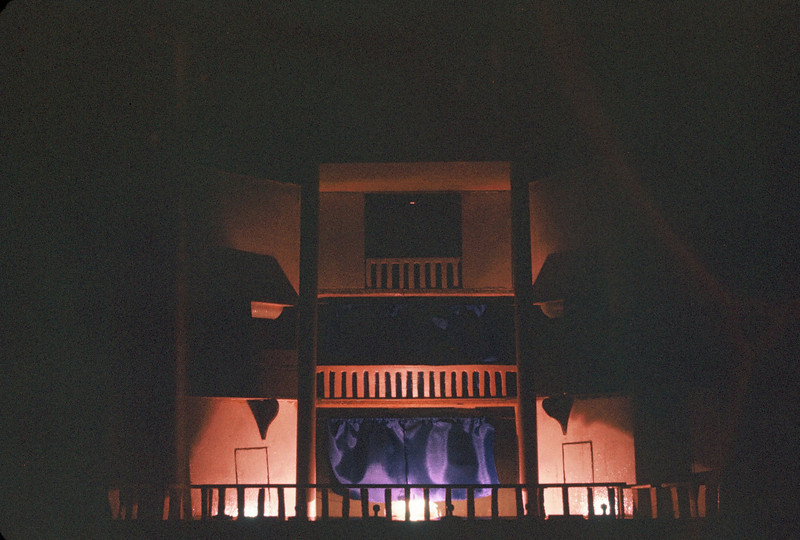 Areas in the Globe Theater are lit up, controlled by switches on a panel