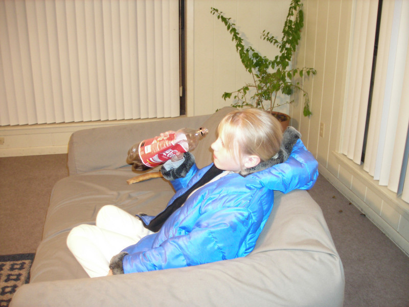 Olivia Watching TV <br /> With Coke in hand.