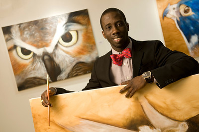 WSU alumni and painter Omar Clarke with some of his work in the Arno Maris Gallery.