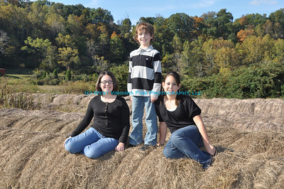 Lindsey, Nathan and Chelsey on the haybales.
