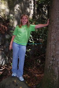 Bailee standing next to tree at Cooper's Rock State Forest.