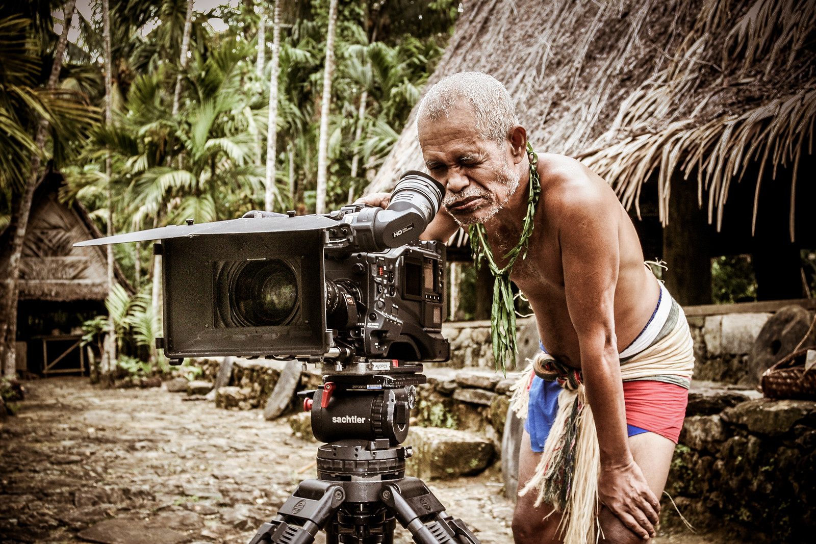 I was filming on the remote Pacific island of Yap - famous for its giant stone money. A local man, with a mouth stained red from the Betle nut he was chewing, was fascinated by our camera and so I let him have a go. #BBCEarth #BBC #EarthOnLocation #Yap #Micronesia #Pacific #Island #People #Camera #Technology