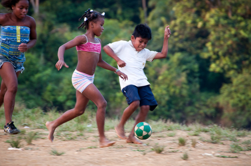 The Guadual Afro-Colombian community lives on the other side of the river. In the afternoons the Guadual children cross the river to play football.