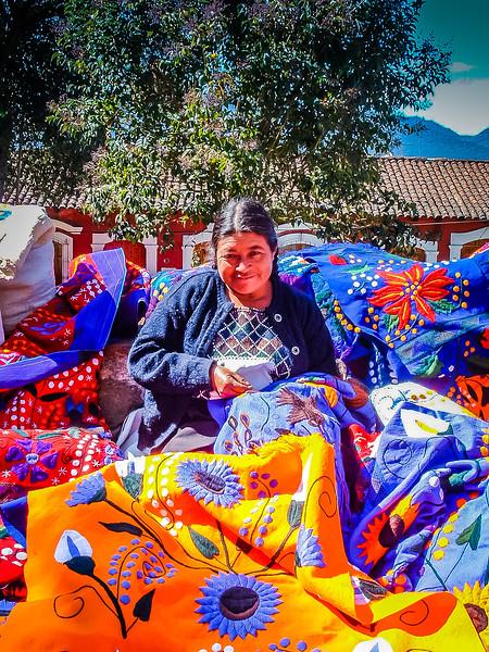 woman selling textiles