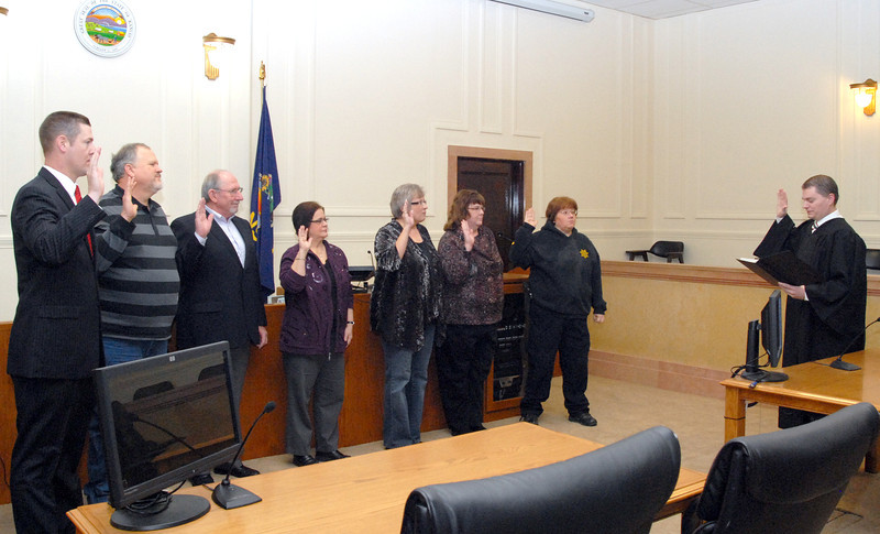 Osage County officers being sworn in by Osage County Magistrate Judge Taylor Wine - Osage County Attorney Brandon Jones, commissioners Ken Kuykendall and Gaylord Anderson, Register of Deeds Linda Massey, Treasurer Jo Ann Hamilton, County Clerk Rhonda Beets, Sheriff Laurie Dunn.