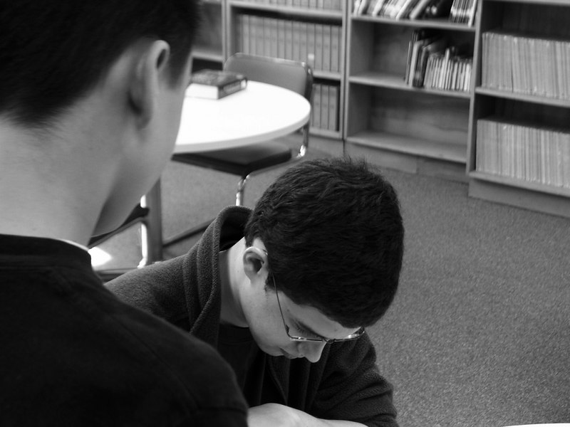 Christopher Paolini signs a copy of his book, Eragon at Gresham Middle School.
