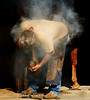 Farrier-somebody has to do it.  The smoke you see is really steam from the horseshoe touching the horses hoof.  New shoes are put on the horses every 5 to 6 weeks just like a haircut.