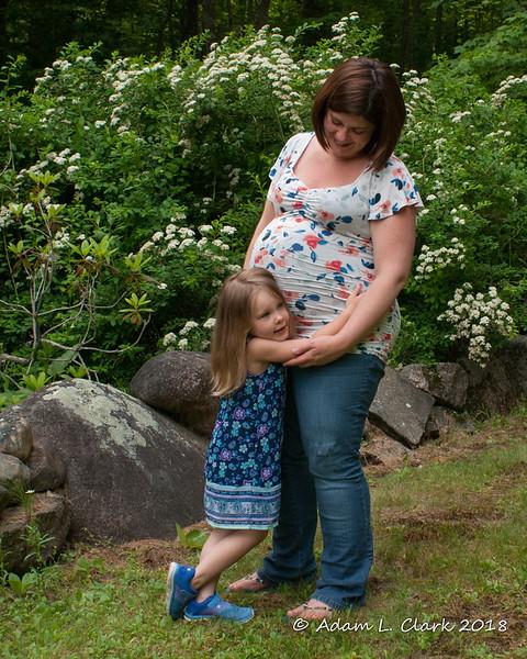 Liliana hugging Melissa's pregnant belly