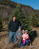 All four of us in front of the tree we picked out